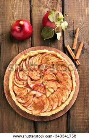 Pie, fresh apples and cinnamon, top view - stock photo