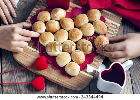 Pie in the shape of heart made from yeast roll buns at Valentine day - stock photo