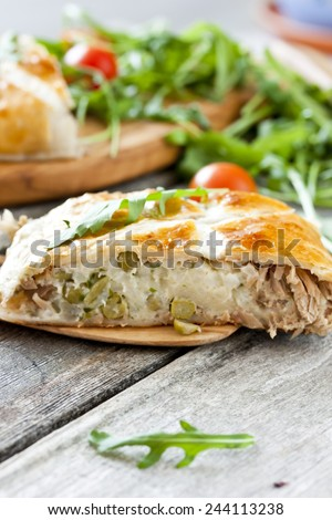 pie of puff pastry with tuna, rice, egg and peas