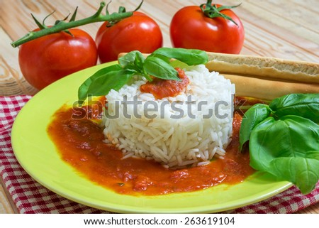pie white rice with tomato sauce and basil