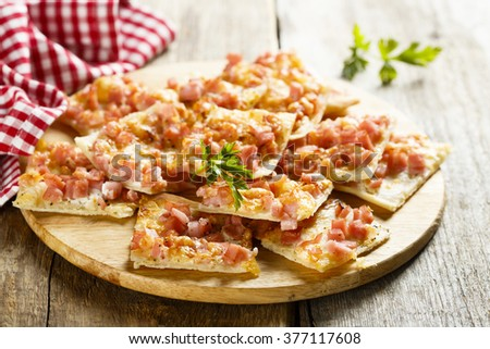 Pie with ham and cheese - stock photo
