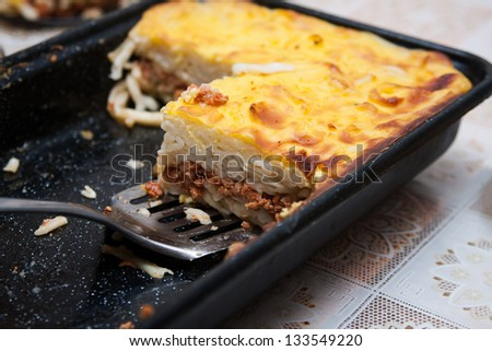 Pie with spaghetti and lamb meat - stock photo