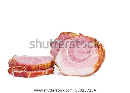Piece and slices of home made pork ham isolated on white background