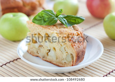 Piece apple pie on the background of the raw apples - stock photo