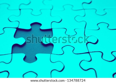 Piece missing from jigsaw puzzle - stock photo