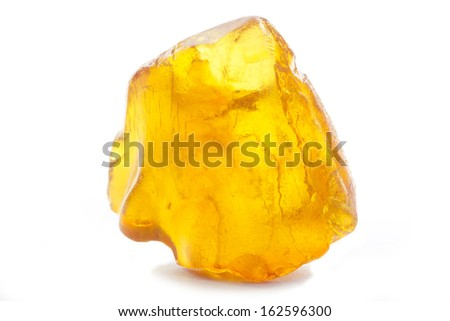 piece of amber isolated on white background - stock photo