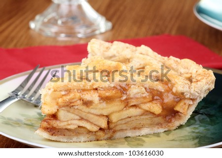 Piece of apple fruit pie on a plate - stock photo