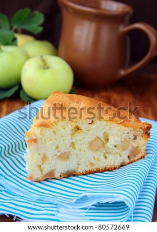 piece of apple pie on a wooden table