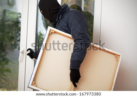 Piece of art stolen from private house by a burglar - stock photo