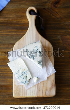 piece of blue cheese on board, food top - stock photo