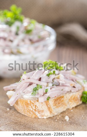 Piece of bread with Meat Salad (detailed close-up shot)