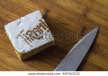 piece of cake cut with a knife on a board