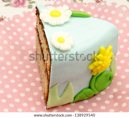 Piece of cake decorated with fondant - stock photo