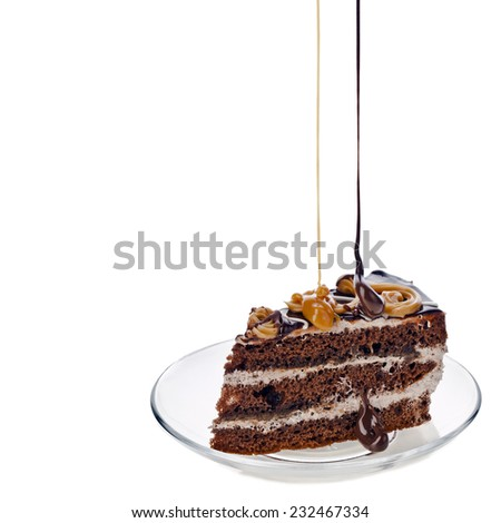 Piece of cake on a glass plate.On a white background - stock photo
