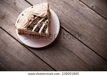 Piece of cake on the wooden table - stock photo
