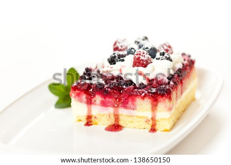 Piece of cake with fresh berry assortment