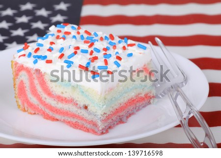 Piece of cake with red white and blue sprinkles with american flag