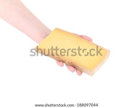Piece of cheese in a man's hand. Isolated on a white background.