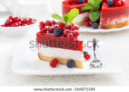 piece of cheesecake with berry jelly on a plate, horizontal - stock photo