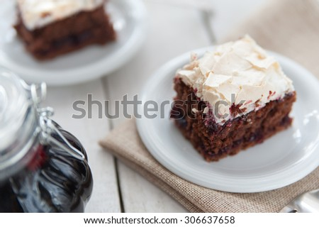 Piece of cherry and meringue cake - stock photo