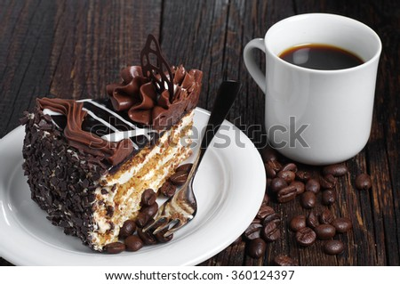 Piece of chocolate cake and cup of coffee on dark wooden table