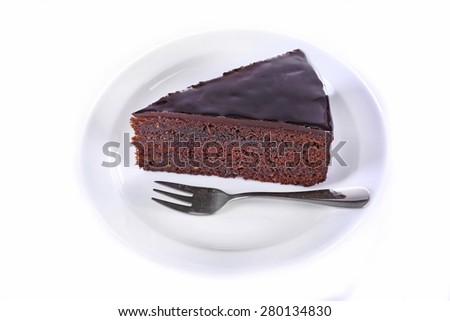 Piece of chocolate cake isolated on white - stock photo