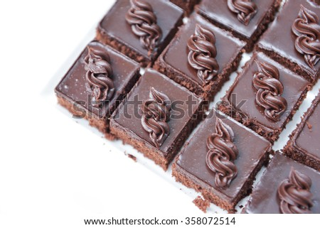 piece of chocolate cake, top view, selective focus, Chocolate cake with rich icing - stock photo