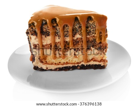 Piece of chocolate cake with caramel isolated on white