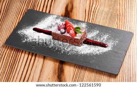 Piece of chocolate cake with fresh berry - stock photo