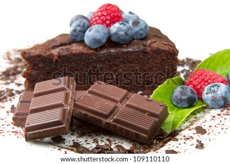 Piece of chocolate cake with fresh berry on white background - stock photo