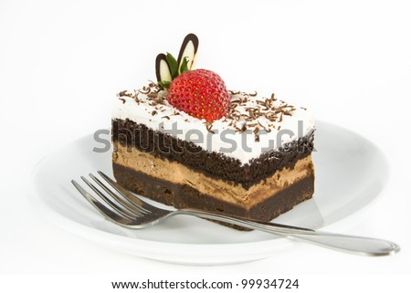 Piece of chocolate cake with strawberry decorate on top - stock photo