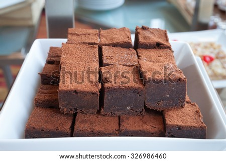 Piece of chocolate royce on bowl. - (Close up) - stock photo