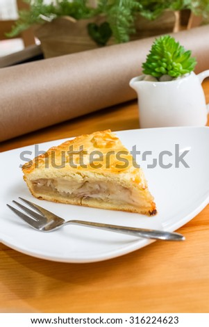 piece of coconut pie on white dish