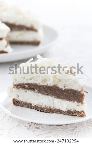 piece of delicious chocolate cake with coconut cream, close-up, vertical, top view - stock photo
