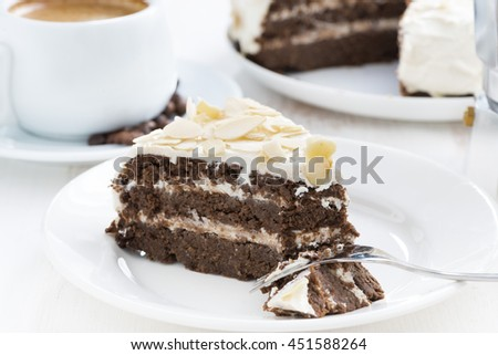 piece of delicious chocolate cake with cream on plate, horizontal - stock photo