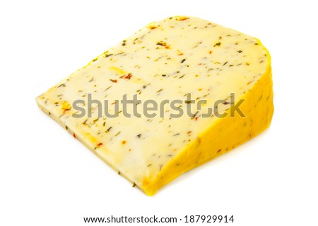 Piece of dutch cheese with italian spices