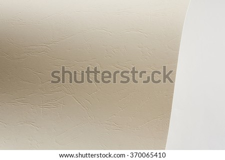 Piece of exture cardboard on gray background - stock photo