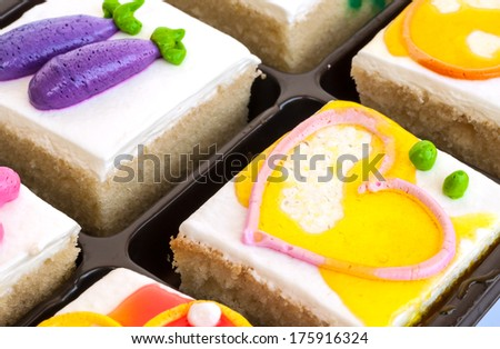 piece of fancy cakes on white background. - stock photo