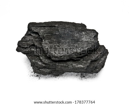 Piece of fractured wood coal isolated over white background. with clipping path - stock photo