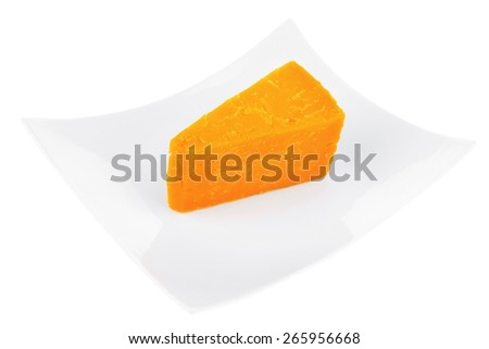 piece of french cheddar cheese on a ceramic plate isolated over white background - stock photo