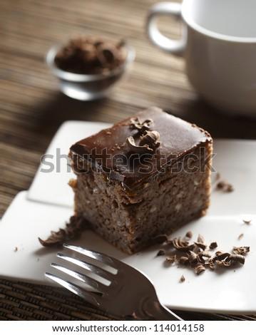 Piece of fresh chocolate cake - stock photo