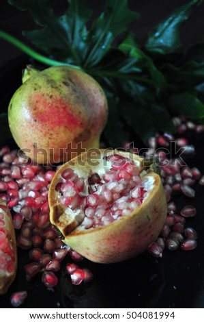 Piece of fresh pomegranate with seed on black background