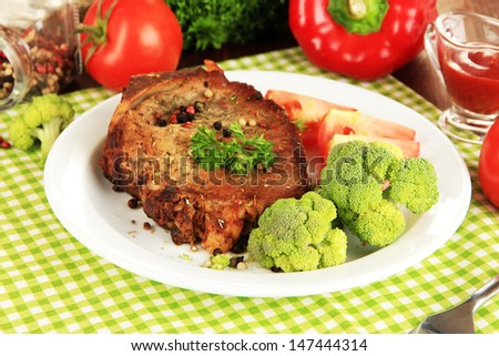 Piece of fried meat on plate close-up - stock photo