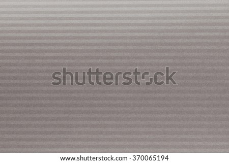 Piece of gray texture cardboard on gray background - stock photo