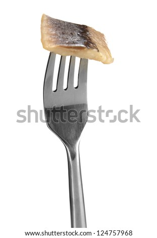 Piece of herring on fork isolated on white