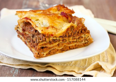 Piece of homemade lasagna, selective focus