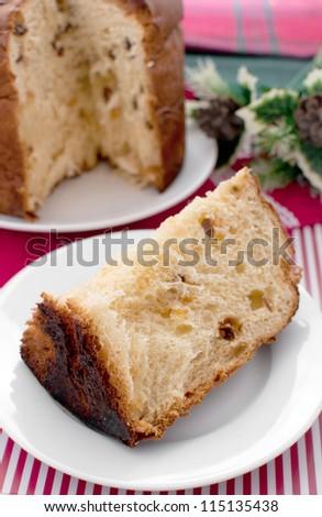 Piece of italian christmas cake panettone - stock photo