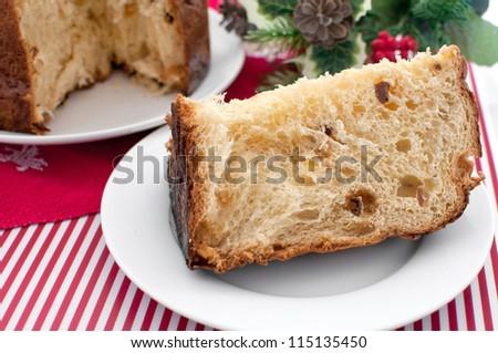 Piece of italian christmas cake panettone horizontal - stock photo