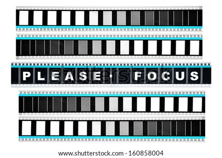 Piece of 35 mm motion film with the word 'please focus' on it - stock photo