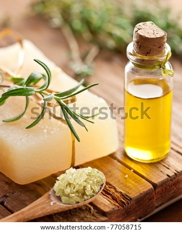 Piece of natural soap with rosemary. - stock photo